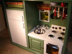 My husband and I made this play kitchen for our grandniece from an old entertainment center. Many of the materials were salvaged or purchased very inexpensively. Diy Play Kitchen, Kitchen Sets, Play Kitchens, Diy Kids Furniture, Furniture Projects, Diy Projects, Old Entertainment Centers, Baby Room Diy, Diy For Kids