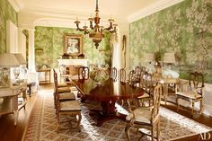 A Gracie chinoiserie paper lines the dining room, which is outfitted with Italian Rococo chairs and custom-made copies; Frederick P. Victoria & Son created the cream-painted consoles, and the carpet is a bespoke Axminster.