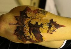 I want this, prob a different scene going on in the design of the leaf buy its awesome! Maple leaf tattoo on forearm
