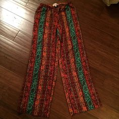 Printed Wide Leg Palazzo Beautiful printed lightweight pants!  Perfect for those spring and summer days or nights!  Only worn once.  There is a weird twist in the elastic around the waist but it was like that since purchase and doesn't affect the wear. Philosophy Pants Wide Leg