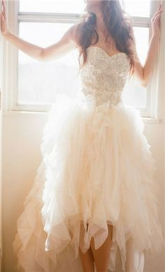 Elegant short wedding dress. If you want the best officiant for your Outer Banks, NC, ceremony, contact Rev. Barbara Mulford: myobxofficiant.com/