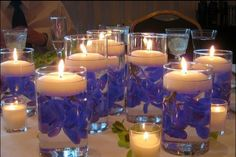 DIY center pieces: glasses diff sizes, water, flower petals of your choice, & a floating candle