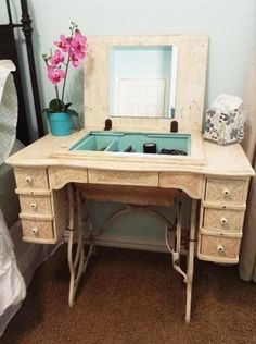 sewing machine vanity | Antique sewing machine cabinet repurposed into a makeup vanity