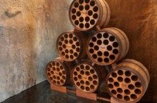 Brilliant idea! Bottle racks from recycled wine barrels.