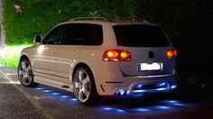 Volkswagen Touareg with blue leds by LLTek...pass on the douche blue LEDs...but love the body kit!