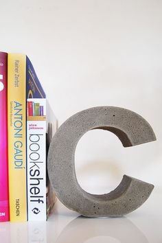 By The (Concrete) Bookend - How To Make DIY Concrete Letters. LOVE the industrial look they add!!!! **