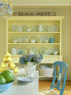 MR F doesn't know it, but our next kitchen will be blue and yellow. - Yellow and blue humanizes the large scale of this dining room and imparts a cottage vibe. The buffet is painted in a pale butter yellow to let a pastel blue-patterned china collection pop.