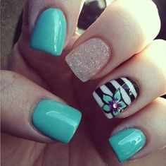 Add fun to your short square shaped nails with this cool looking nail art ensemble. The aquamarine matte nail coat is just amazing to look at and takes you towards the sea. Being distinct from the rest is a fresh sparkly glitter coated nail and a stripe black and white design topped with a blue and purple hibiscus combination. Artsy and fun to look at nail art design.