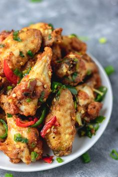 These salt and pepper chicken wings are full of flavours and would your takeaway a run for their money. easy Salt and pepper chicken wings to make at home Chicken Wing Recipes, Baked Chicken, Thai Chicken Wings Recipe, Pan Fried Chicken Wings, Chicken Wing Marinade, Chicken Legs, Roast Chicken, Salt And Pepper Chicken, Chicken Stuffed Peppers