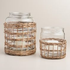 Bring a coastal vibe to your decor with our glass hurricane encased in a removable gray-washed willow basket - a beachy backdrop for a glowing pillar candle. www.worldmarket.com #CelebrateOutdoors