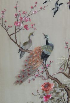 Chinese silk embroidery on silk panel of a peacock perched on a flowering plum branch with peonies and other birds, circa 1870