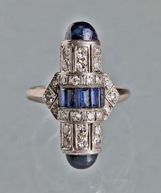 Art Deco sapphire & diamond ring from Tadema Gallery, ART DECO Cartier Inspired Ring Platinum Sapphire Diamond H: cm in) Probably French, Circa 1925 Ring Case 38 diamonds cts approx 7 baguette sapphires & 2 cabochon sapphires cts approx Bijoux Art Deco, Art Deco Jewelry, Fine Jewelry, Jewelry Design, Antique Jewelry, Vintage Jewelry, Antique Art, Vintage Rings, Silver Jewelry