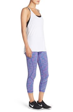 Working out in style with this cute ensemble. Simple tank paired with fun leggings will add a punch to the active wear.