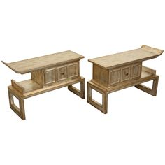 I love these tables! James Mont with an antiqued silver leaf finish. I use these as bedside tables. So chic!