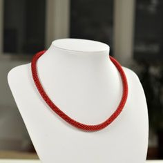 Unique handmade red bead necklace made of red beads and white thread.