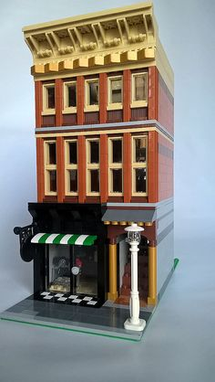 morecitybricks latest build is a camera shop. The three story modular building uses a brown and tan color palette and makes for an excellent addition to any LEGO town.