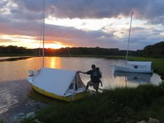 A pair of Marsh & Bay's O'Day Daysailer's face sunset.  Two nice (but different) tents.