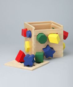 This shape-sorting cube features 12 vibrantly colored shapes that each make a satisfying clink as they drop into the cube. After they're all in, open the lid, take them out and start all over again. It's perfect for teaching little ones about shapes and colors.Includes 12 shapes and cube6.8'' W x 6.8'' H x 6.3'' DWood /...