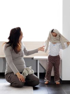 Dressing Skills: Teaching Your Child How to Dress Herself: How to stock your toddler's wardrobe so learning how to get dressed will be easy, and tips to make it fun!