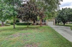 7029 Quail Woods Road, Wilmington, NC 28411       MLS: 526514     Bedrooms: 3     Baths: 2     Partial Baths: 0     SQ FT: 1202     Lot Size: .37     Style: Ranch     Garage: 3 Car     Heat Source: Electric     Schools: New Hanover (Elementary School: Murrayville; Middle School: Trask; High School: Laney; Year Round: E
