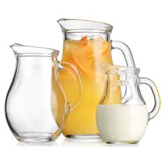 Set of 3 handled glass pitchers with embossed measurements.    Product: Small, medium and large pitcherConstruction...