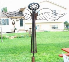 Angel made of recycled metal items.