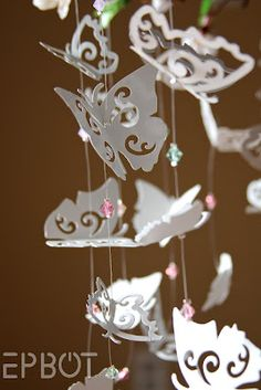 EPBOT: Sweet DIY Butterfly Mobile - not as a mobile, but maybe as hanging decorations. Butterfly Mobile, Butterfly Crafts, Butterfly Design, Diy And Crafts, Crafts For Kids, Paper Crafts, Decor Crafts, Paper Art, Paper Butterflies