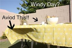 clever idea for keeping that table cloth On the table in a wind..  :o)