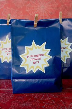 Superhero Goodie Bag - The kits were filled with: bat-a-rangs kyrtonite crystal sticks (glowsticks) spiderman wrist bands pop rocks superhero pez candy dispenser with candy iron man blower batman velvet poster Superhero School Theme, Superhero Teacher, Superhero Birthday Party, School Themes, Classroom Themes, Superhero Ideas, Superhero Gifts, Math Classroom, School Ideas