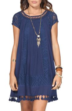 Flirty lace accents elevate this flouncy trapeze dress cut from soft, stretch cotton.