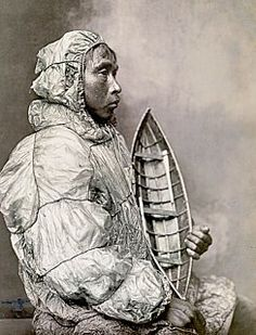 Fabulous shot from 1900 of a tuilik made from cured walrus intestine. I would have guessed that it was modern mylar.