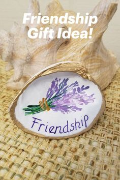 """Unique hand-painted shell with """"friendship"""" greeting. Comes in a pretty blue drawstring pouch for easy gifting. Charming! Friendship Messages, Friendship Gifts, Seashell Painting, Painted Shells, Beach Gifts, Shell Beach, Presents For Friends, Shell Art, Lavender Flowers"""