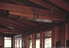 Gamble house (1908-1909 CE) Pasadena - functional straps and wedges bind Oregon Pine corbels in the 3rd-floor attic.