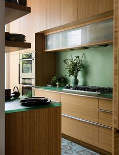 kitchen with bamboo cabinets and resin countertops ||  3-form.com counters, henrybuilt cabinets/pulls
