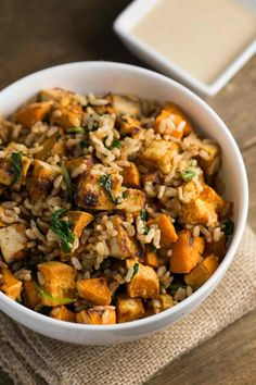Tofu Sweet Potato Bowl with Sweet Tahini Sauce   via veggiechick.com #vegan