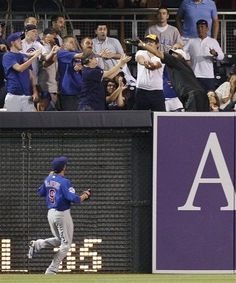 Game #113 8/7/12: A fan reaches to snare the home run of San Diego Padres' Carlos Quentin as Chicago Cubs right fielder David DeJesus watches during the fourth inning of a baseball game Tuesday, Aug. 7, 2012, in San Diego. (AP Photo/Lenny Ignelzi)