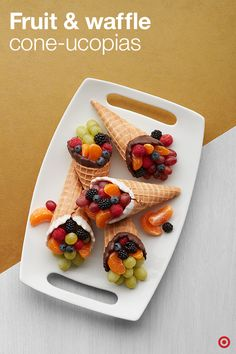 """Here's an easy treat: Fruit & Waffle Cone-ucopias. Simply melt your chocolate of choice and dip waffle cones for an extra-sweet bite. Fill the cones with fruit like berries, grapes and clementines for a healthy, festive snack. It's kids' table-approved and perfect for your friends or relatives who """"aren't into pie."""""""