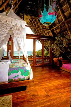 Ahau Tulum, Tulum, Mexico ~ Simple luxury on the beach, beautifully hidden in the jungle. Choose between a palapa, villa or a Bali hut (pictured). Snorkel in cenotes & natural reserves. Tulum has some of the best cave diving in the world. Cancun Underwater Museum and Mayan ruins are nearby. Eco-friendly. http://ahautulum.com/