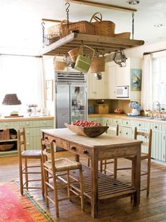 Dishfunctional Designs: Creative Upcycled Kitchen Pot Racks. Especially like this one over the table/island.