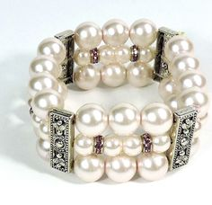 Tasteful and sophisticated, this wide bracelet lines three rows with pearls and faceted purple beads. Shop now: https://www.noblag.com/fashion-jewelry/silver-tone-crystal-pearl-multi-row-stretch-bracelet.html