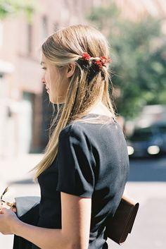 Flower in her hair. (Photo by Vanessa Jackman)