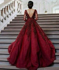 bd757ca7fa6 She wore a blood red dress with delicate appliques in the front. It looked  like red roses would bloom from the blood colored silk.