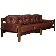 Brazilian plum leather and exotic wood sofa