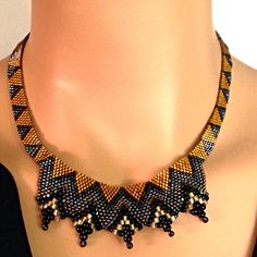 Gold and black flat Cellini necklace.