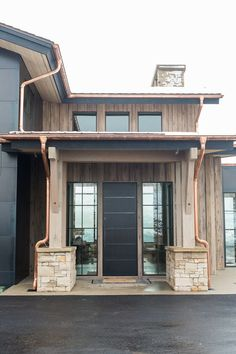 Modern+mountain+home+with+stone,+wood,+and+metal+exterior.jpg