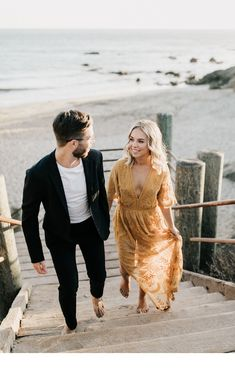 A dressy beach engagement in Malibu. Love the combo of her yellow dress and his … A dressy beach engagement in Malibu. Love the combo of her yellow dress … Beach Engagement Photos, Engagement Photo Outfits, Engagement Dresses, Engagement Couple, Dresses For Engagement Pictures, Engagement Session, Engagement Ideas, Couples Beach Photography, Engagement Photography