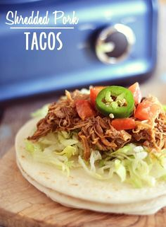 Make taco night a breeze with these Shredded Pork Tacos made with the Crock Pot