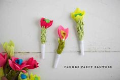 http://ohhappyday.com/2012/10/flower-party-blowers/
