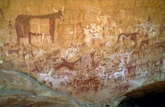 Painted human figures, cattle, camel and horse riders. Ennedi Plateau, Chad. © David Coulson/TARA