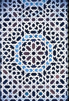 Image MOR 0203 featuring decorated area from the Bou Inaniya Medersa, in Fez, Morocco, showing Geometric Pattern using ceramic tiles, mosaic or pottery.